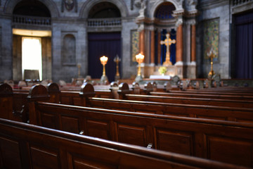 Papiers peints Lieu de culte Interior of Catholic church with selective focus on benches