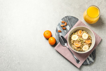 Tasty healthy breakfast served on light grey table, flat lay. Space for text