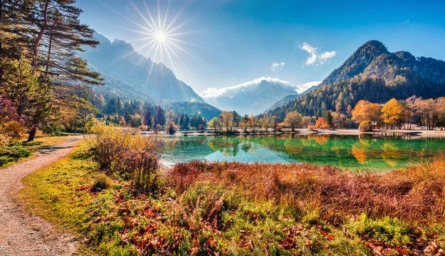 Sunny morning view of Jasna lake. Attractive autumn scene of Julian Alps, Gozd Martuljek location, Slovenia, Europe. Wonderful landscape of Triglav National Park. Traveling concept background.