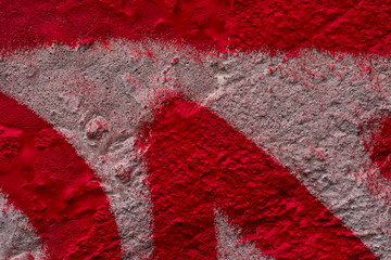 Art under ground. Beautiful street art graffiti background. The wall is decorated with abstract drawing red paint. Modern style urban culture of street youth. Abstract picture on wall