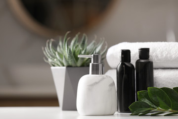 Wall Mural - Composition with soap dispenser and towels on white table indoors. Space for text