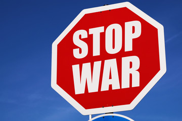 Stop war sign against blue clear sky