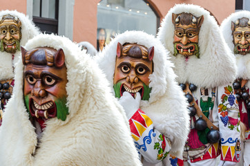Typical carnival costumes and masks at a traditional parade in Southern Germany