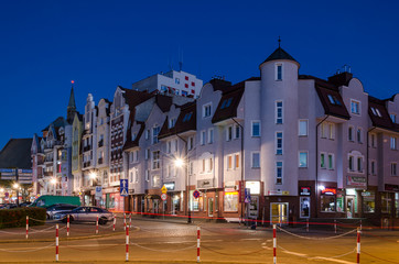 KOLOBRZEG, WEST POMERANIAN / POLAND - 2018: Crossroads of streets and residential homes in the city center