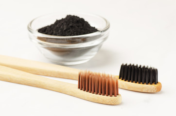 Bamboo toothbrush with black charcoal toothpaste powder
