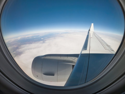 Looking out the window of a jet airplane over the wing and engine and seeing an apparent curvature of the Earth
