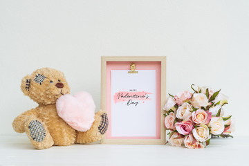 Mockup Picture frame and cute bear with pink heart and Bouquet of roses . Valentines Day Background concept with copy space. Mock up with photo frame for your picture or text