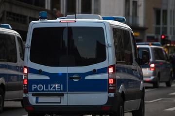 Fototapeta german police trucks in the evening