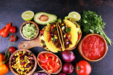 Mexican tacos with beef, tomatoes, avocado, chilli and onions. Handmade tortilla with pork Wall mural