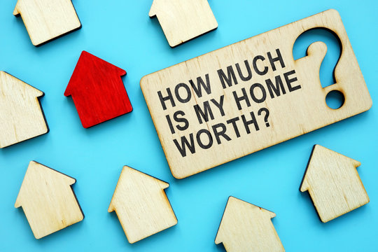 How Much is My Home Worth sign and red house model.