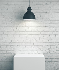 Blank brick wall, podium and lamp