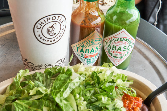 Chipotle plate with tabasco sauce and drink.