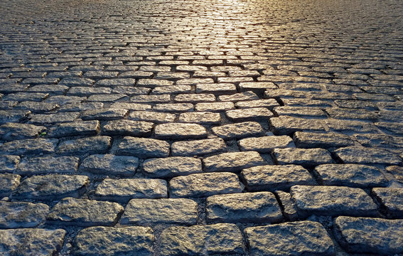 Light shining on a cobblestone street background texture, New York City