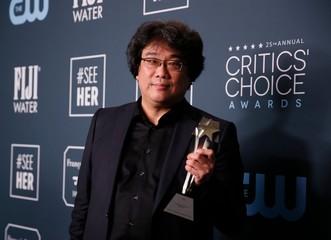 "25th Critics Choice Awards – Photo Room– Santa Monica, California, U.S., January 12, 2020 - Bong Joon Ho poses backstage with his Best Foreign Language Film award for ""Parasite\"