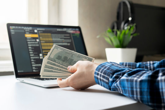 working at home. side hustle, person earned money via computer using internet.