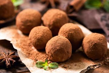 Homemade chocolate truffles with cocoa powder closeup view. Tasty chocolates, confectionary concept