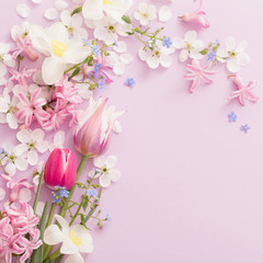 beautiful spring flowers on paper background