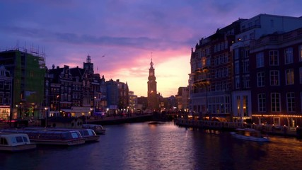 Fototapete - Timelapse of Amsterdam Cityscape, Coin Tower and Amstel River with Dramatic Clouds, Holland, Netherlands