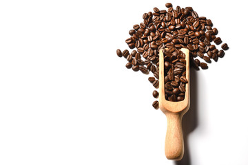 Coffee beans in wooden spoon on white background
