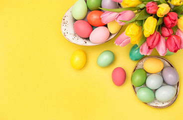 Easter eggs decoration tulip flowers yellow background