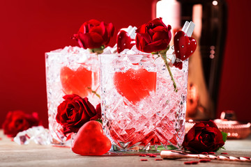 Roses julep Valentine's day cocktail with red roses and hearts on a festive background