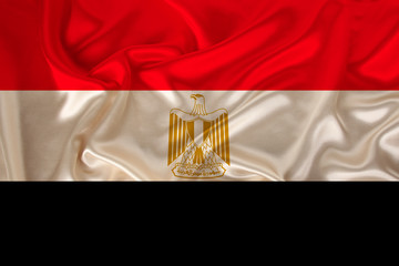 photo of the national flag of the state of Egypt on a luxury texture of satin, silk with waves, folds and highlights, close-up, copy space, illustration