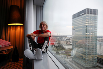 "French climber Alain Robert, also known as ""Spiderman"" poses for a picture in his hotel before an interview with Reuters, near Paris"