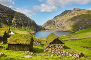 Picturesque green landscape with black houses in Faroe islands. Saksun