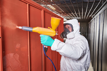 polymer coating of metal detail with powder spraying gun