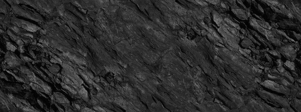 Black grunge background. Abstract stone background. Beautiful mountain texture pattern. Stone grunge banner. Dark gray rock backdrop.