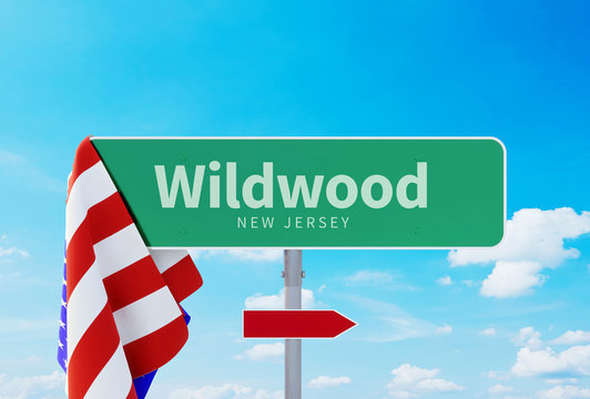 Wildwood – New Jersey. Road or Town Sign. Flag of the united states. Blue Sky. Red arrow shows the direction in the city. 3d rendering