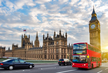 Foto auf Gartenposter London roten bus Houses of Parliament with Big Ben and double-decker bus on Westminster bridge at sunset, London, UK