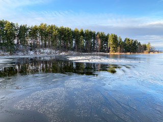 Thin ice on lake Seliger in warm winter. Russia, Tver region, Ostashkov city
