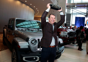 Jim Morrison, Head of Jeep Brand FCA North America, holds up the trophy after winning the 2020 North American Truck of the Year for the 2020 Jeep Gladiator in Detroit