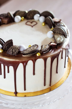 holiday cake with chocolate on a table on a light background