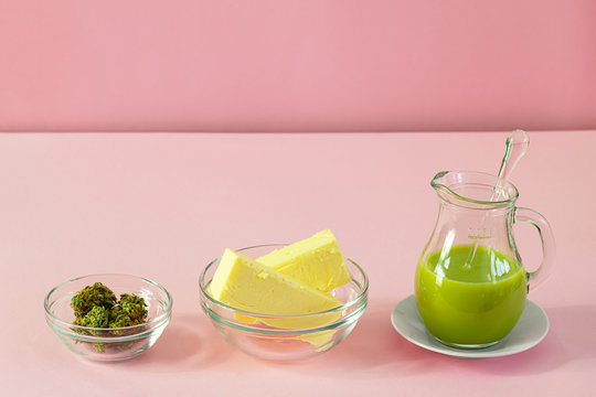 Making Cannabutter for Baking Edibles with Butter and Cannabis or Hemp on Pink Background with Copy Space