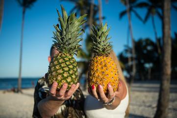 Pineapples in hands