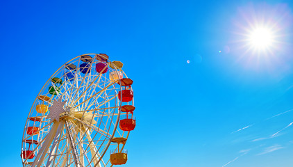 Ferris wheel on Mount Tibidabo Spain Barcelona. Sunny day with blue sky aerial view.