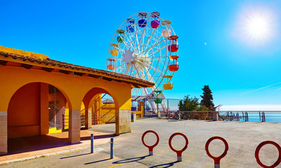 Canvas Prints Amusement Park Entrance in amusement park at Mount Tibidabo Barcelona Spain with Ferris wheel attraction. Ticket office building.