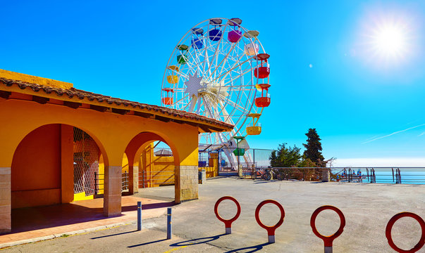 Entrance in amusement park at Mount Tibidabo Barcelona Spain with Ferris wheel attraction. Ticket office building.