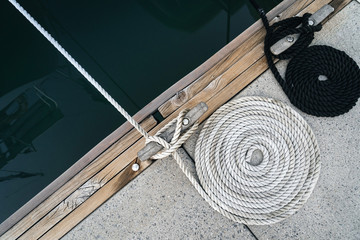 Mooring rope twisted into a spiral on a wharf.