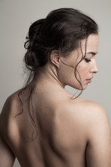 natural beauty concept woman with wet hair in bun profile studio shot
