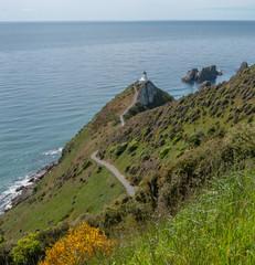 Lighthouse. Kaka point. Nugget Point. Catlins. South island coast. New Zealand. Ocean.