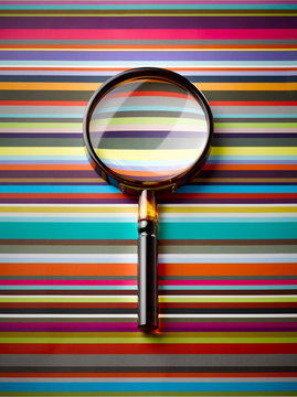 Magnifying glass on striped background