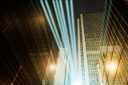 Fiber optic light trail communication technology streaming through highrise buildings, concept