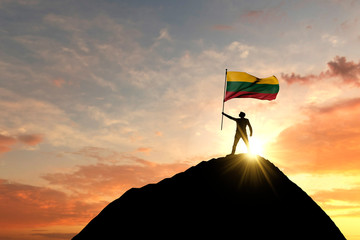 Lithuanian flag being waved at the top of a mountain summit. 3D Rendering