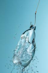 Hook pulling exploding plastic water bottle