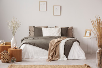 Spacious bedroom interior in beige and olive colour Fotobehang