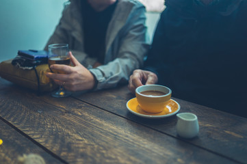Retired couple drinking coffee and cider in cafe