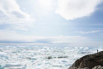 Glacial ice melting below sunny sky Greenland